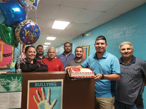 picture with a Cake from the Superintendent and Roma ISD School Board