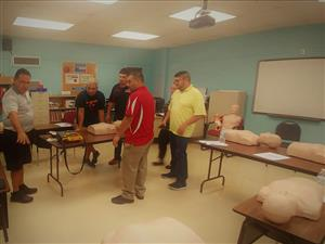 practicing CPR steps